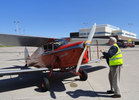 Pilot Dick Felix starting up the engine of the 1936 Hornet Moth