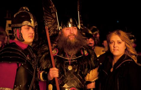 The Guizer Jarl with son Stuart and daughter Suzanne in reflective mood at the burning site.