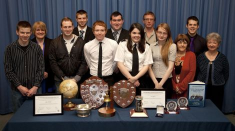 Students and lecturers with their awards, back row (left to right): Caroline Hepburn (Student Support Officer- for Ryan Trumpess), Joe Pottinger (for Steve), Calum Fraser, Harry Pottinger (for Callum), Derek Spence; front row (left to right): Ben Hughson, Joe Huntley, Colin Hodder, Jerry Gibson, Abigail Barlow, Maddie Thomas, Kathleen Cumming - Photo: Billy Fox for NAFC Marine Centre