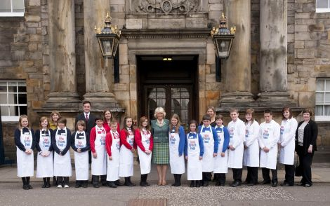 Standing at the right of the group with Camilla, Duchess of Cornwall, at Edinburgh's Holyroodhouse palace are (from right) Moira Dobson, Sianlee Lawson, James Spall, Danielle Johnson and Craig Manson. Pic. Peter Adamson