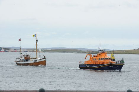 The Shetland Bus vessel Heland being towed into Lerwick harbour on Sunday morning.