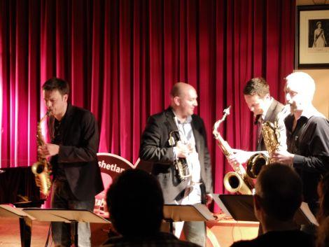 Brass Jaw belt it out. From left: Paul Towndrow (alto sax), Ryan Quigley (trumpet), Konrad Wisniewski (tenor sax) and Allon Beauvoisin (baritone sax). Pic. Chris Brown
