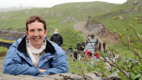 Crime writer Ann Cleeves in South Whiteness on Wednesday with the 'crime scene' in the background - Photos: Shetland News