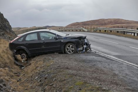 This car was badly damaged when it came off an icy stretch of road north of Voxter on the B9076 near Brae on Friday morning. Pic. Ivan Hawick
