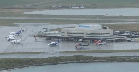 Sumburgh airport in November with fixed wing and rotary aircraft lining up to handle the growing oil-related passenger traffic.