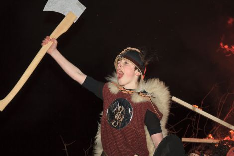 Guizer Jarl Murray Peterson in front of burning galley - Photos: Olivia Abbott