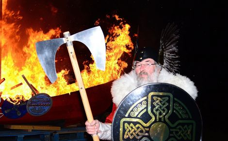 Guizer Jarl John Laurenson with his burning galley Aumstr - Photo: Mark Berry