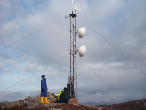 Connected! The mast with its turbine and dishes on top of Engamoor at West Burrfirth - Photo: Shetland Broadband