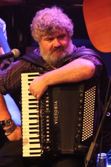 Local accordionist Peter Woods waits his turn. Can't you tell he's loving it? Photo Davie Gardner
