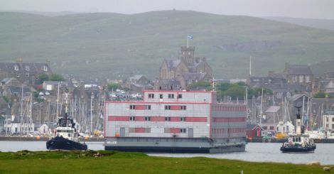 The accommodation barge is being towed into Lerwick harbour on Friday morning - Photo: John Bateson