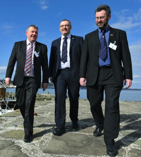 Island council leaders Angus Campbell, Gary Robinson and Steven Heddle in Lerwick on a sunny day in May this year. Photo Malcolm Younger