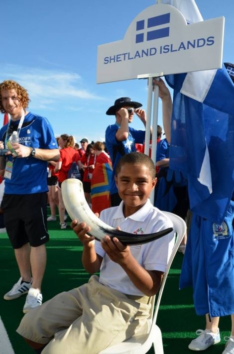 Standard bearer and team mascot Aaron holding the horn in which Andrea Strachan delivered Shetland's pint (of water) for the opening ceremony. Photo Andrew Inkster