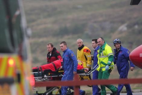 One casualty was taken on a stretcher to a waiting ambulance - Photo: Garry Sandison