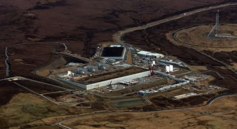 An aerial view of the Shetland Gas Plant as it takes shape, with the two large peat stores clearly visible.