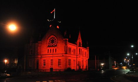 Lerwick Town Hall turned red as World Aids Day is marked - Photo: ShetNews