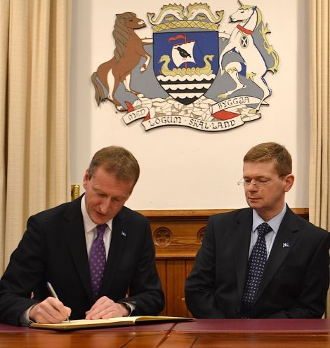 Shetland MSP Tavish Scott (left) and council convener Malcolm Bell signing the book of condolence in Lerwick town hall on Monday - Photo: BBC