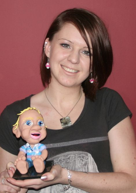 Self-made entrepreneur Donna Simpson with one of her popular Mootie Me bobble heads - Photo: Chris Cope