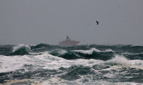 A standby vessel braving stormy seas on Sunday. Photo: Ian Leask