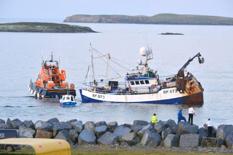 Prospect being towed by the Lerwick lifeboat shortly before she sank on 5 August last year. Photo Malcolm Younger