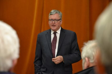 SNP minister Fergus Ewing speaking in Sandwick's Carnegie Hall on Monday night. Photo: Shetnews