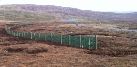 Northmavine's new snow fence ready to catch any last minute snow. Photo Shetnews