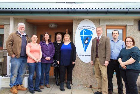 Shetland MSP Tavish Scott stands with Urafirth primary school parents fighting SIC closure plans. From left: Robin Sinclair, Charlene Johnston, Robyn Robertson, Pamela Ruddick, Clare Pottinger,Tavish Scott, Ryan Sandison and Claire Herridge.