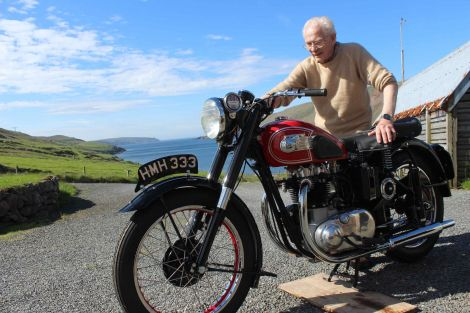 Jackie Edwardson with his old BSA A7 outside his Heylor home. Photo Shetnews