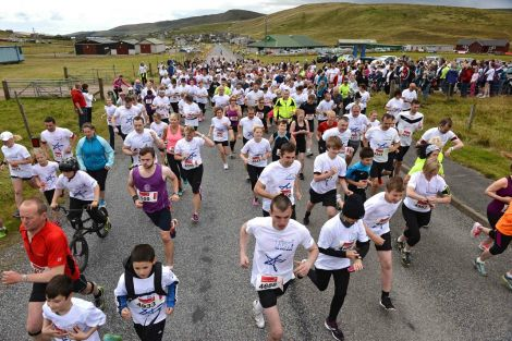 Participants at the start of Mind Your Head's fun run at Cunningsburgh on Sunday. Photo: Malcolm Younger
