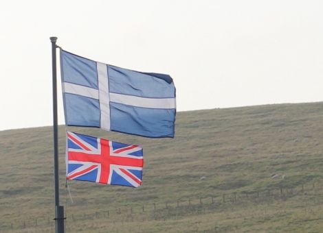 The Shetland flag above the Union Jack flying on referendum day in Northmavine reflecting the view of two thirds of island voters.