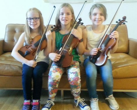 Fiddle talent. (From left) Jodie Smith, Jasmin Smith and Anya Johnston hoping to make it onto national TV at Tuesday's Britian's Got Talent auditions at Mareel.