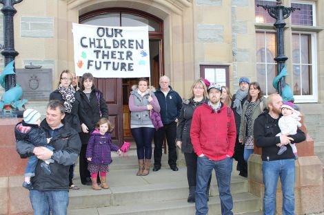 Urafirth parents outside Lerwick Town Hall on Wednesday morning. Photo: Shetnews/Hans Marter
