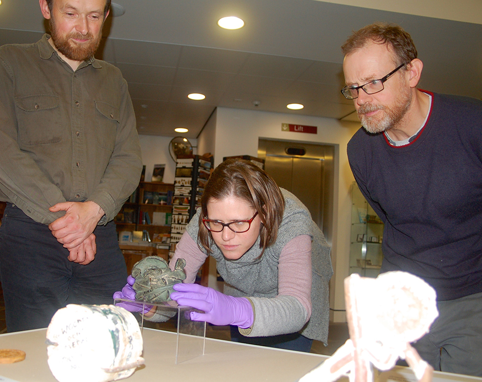 Imogen Gunn, collections manager from the Cambridge University Museum of Archaeology and Anthropology, places the bronze armlet on display under the watchful eyes of Shetland Museum curator Ian Tait and exhibitions officer John Hunter, who will be running bronze casting workshops for the two month duration of the exhibition.