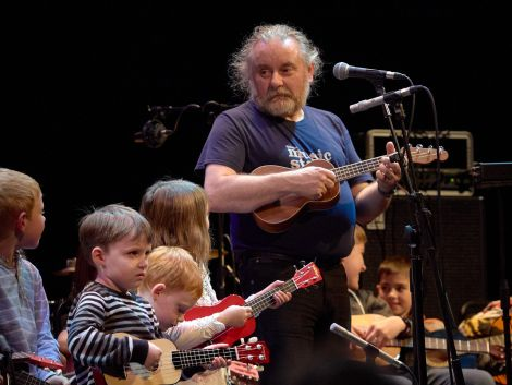 Brian Nicholson leads a group of ukulele-wielding youngsters on Saturday night. Photo: Chris Brown