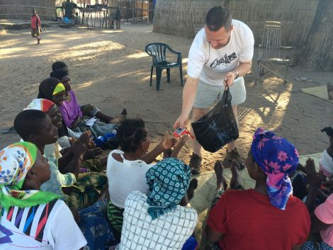 Wylie hands out wind up torches in Malawi this year to help people attend medical services after dark.