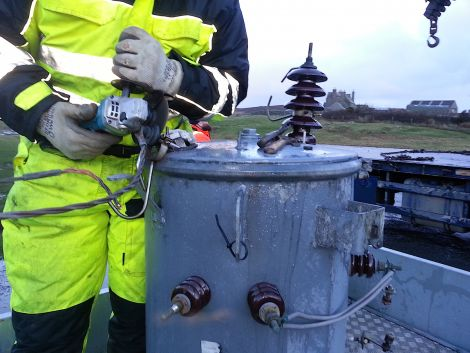 An SSE engineer preparing the transformer to be transported away after it had been hit by lightning in the early hours of Saturday.