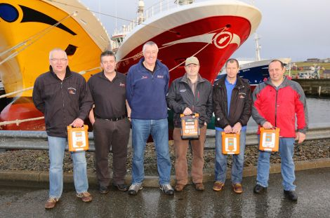 The training team visited Whalsay to carry out training last week. From left: John Ellis, Ross Cowie, Neil Campbell, Jimmy Tulloch (Charisma), Hamish Corrigall and William Polson (mate on the Charisma).​