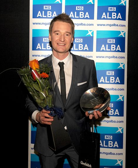 Kevin Henderson with his father Davie's award at the Scottish Trad Music Awards on Saturday night. Photo: Louis DeCarlo