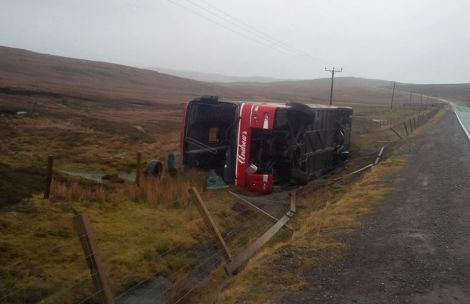 An Andrew's Adventure bus by the roadside. No-one was hurt. Photo: Gordon Harmer