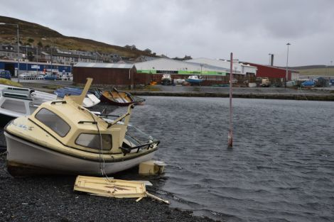 Damage to a boat tied up across the road from Bolts. Photo: Shetnews