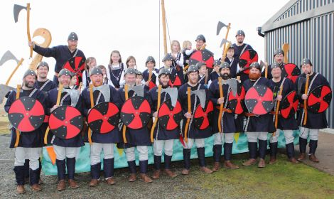 Guizer jarl Malvyn Clark with his squad of 15 Vikings, seven boys and eight princesses.