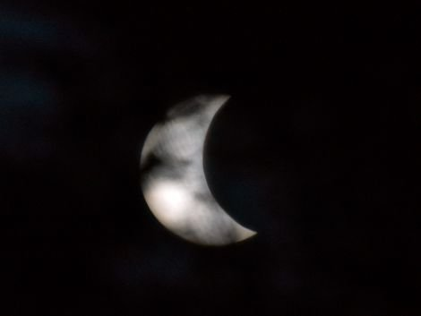 The sun partially obscured by the moon's shadow - Photo: Chris Brown