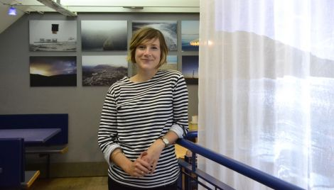 Self-taught photographer Floortje Robertson with her exhibited work in the Peerie Shop this week. Photo: Shetnews/Neil Riddell