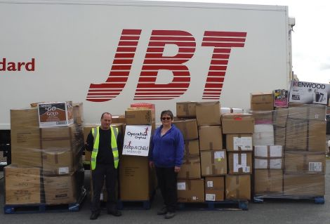 Julie Odie pictured with JBT's Tony Monaghan and the parcels bound for Moldova.