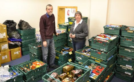 """Salvation Army corps officer Angela Nunn and part time worker David Grieve at the North Road food bank last December, since when demand has grown """"massively"""". Photo Shetnews"""