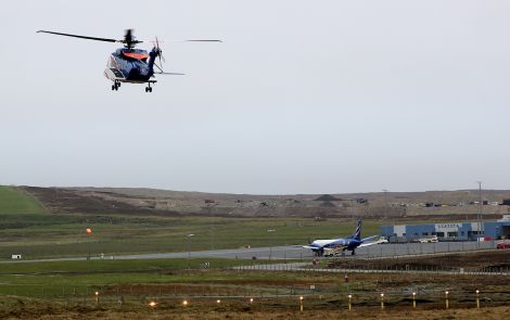 A Bristow helicopter takes off from Scatsta airport taking workers to the North Sea oil fields.