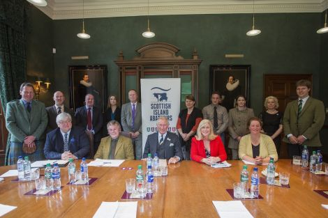 Scalloway crofter Ronnie Eunson (centre left next to the Prince of Wales) is chairing the new Scottish Island Abattoir Association.