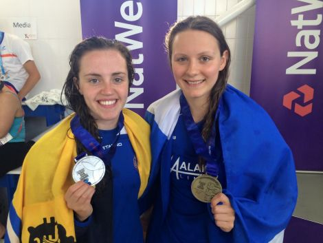 The unstoppable Andrea Strachan (right) with her third gold medal of the games after winning Thursday's 100m individual medley. She is pictured with silver medal winner Kara Hanlon. Photo: Shetland Island Games Association