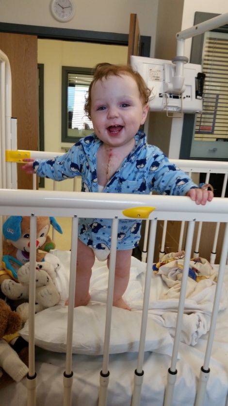 A happy Joshua in hospital after the operation.