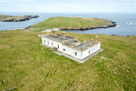 Two dilapidated former lighthouse keepers' houses require some major investment to become inhabitable again.
