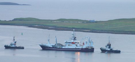 Resolute getting assistance from the harbour tugs this morning. Photo: Ian Leask